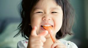girl-eating-yogurt-1038x576